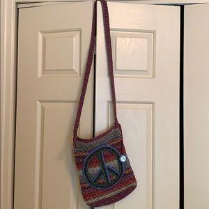 The Sak Crochet Peace Sign Crossbody Purse